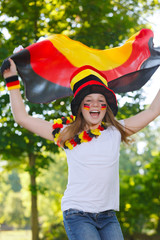 german soccer fan waving her flag