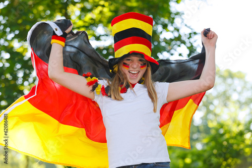 canvas print picture german soccer fan waving her flag