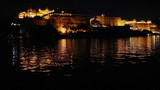 palace on lake in Udaipur at night - India