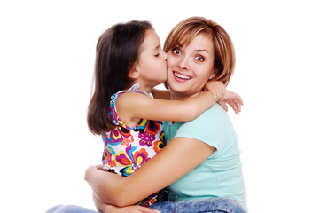 girl kissing surprised mother