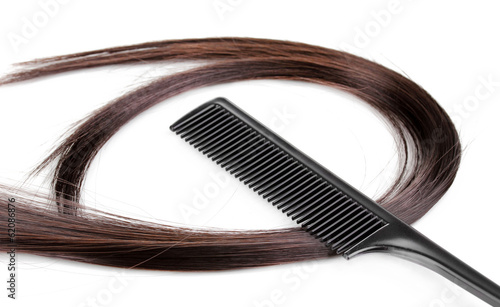 Shiny brown hair and comb isolated on white