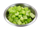 Chopped celery in stainless steel bowl