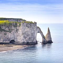 Etretat Aval cliff and rocks landmark and blue ocean . Normandy,
