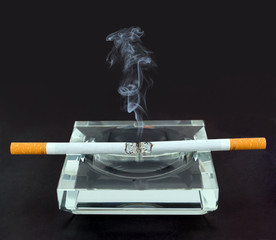 Two lighted cigarette in an ashtray