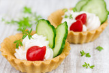 Tartlers with cream, pepper and cucumber