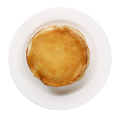 yellow pancakes on a white plate isolated
