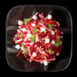 Beetroot and pear salad isolated on black