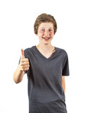 boy with retainer smiles and gives thumbs up sign