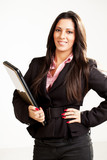 Businesswoman standing and holding laptop.