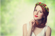 Beautiful redhead women with wreath