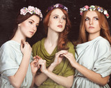 Three beautiful girls  in wreath.