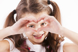 Child making a heart with her hands