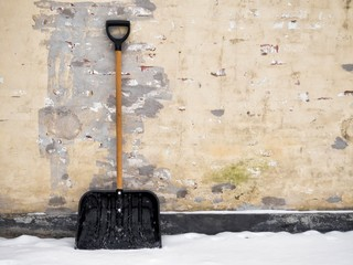 Snow shovel out in the snow