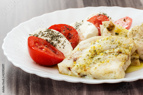 roasted fish and Italian caprese salad
