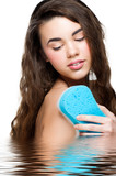 Woman with bath sponge