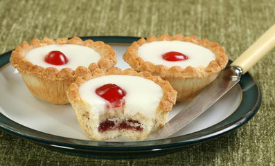 cherry bakewells on a plate