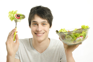 Man eating organic healty salad for perfect diet. Green for life