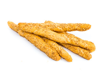 Sesame breadsticks isolated on white background