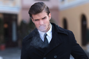 portrait of young business man smoking