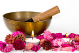 Tibetan bowl, flowers and candles.