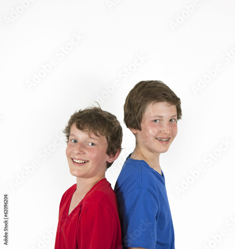 teenage brothers in red and blue shirt hugging and posing