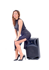 Beautiful sexy young woman posing with audio equipment