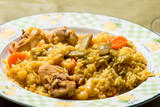 plate of chicken and rabbit paella