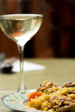 Traditional Spanish food, rice with rabbit and wine glass