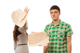 Young woman tossing aside papers