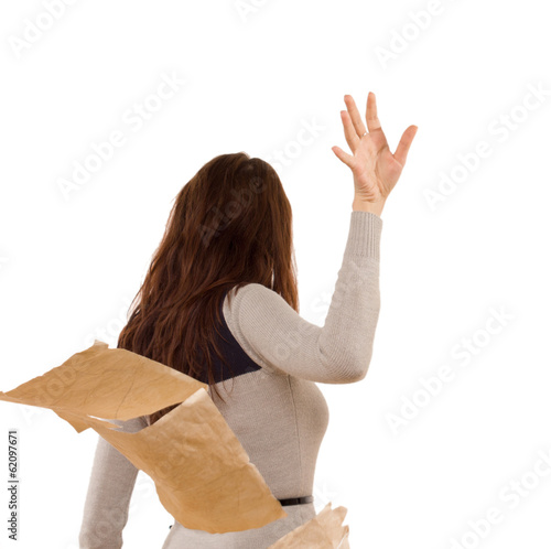Woman tossing aside papers in anger