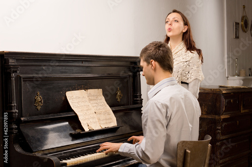 Young couple practicing a musical duet