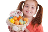 Portrait of little girl with Easter egg basket
