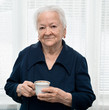 Old woman enjoying tea cup