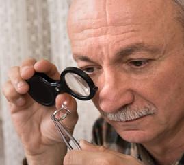 Image of jeweler examining jewel