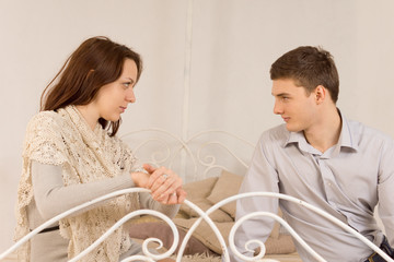 Young couple sitting having a private discussion