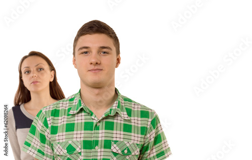 Smug young man being watched by his girlfriend