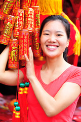 young woman hold a chinese decoration firecrakers