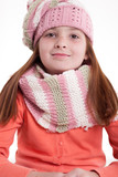 young girl with pigtails in winter clothes