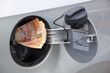 Concept South African Banknotes Feeding Into Petrol Tank