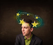 Young man with yellow stars circleing around his head