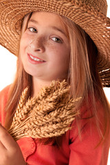 girl with the freckles and straw hat holding in his hand a  whe