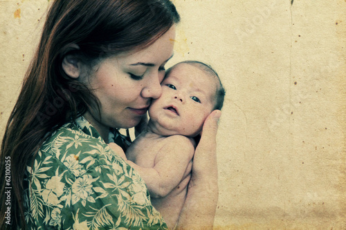 young mother with her baby. Photo in old image style