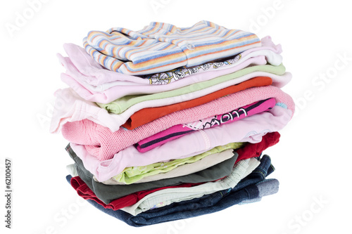 Pile of baby clothes isolated on white