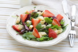 gourmet salad with fresh strawberries and cheese