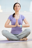 Portrait of modern healthy yoga woman wearing smart watch device