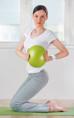 Portrait of modern healthy woman wearing smart watch device with