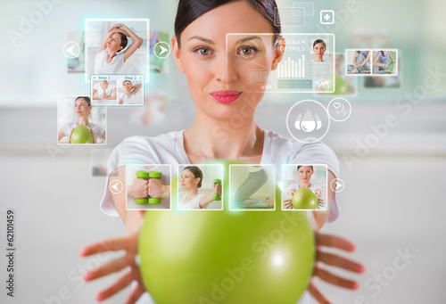 Sporty woman working out using modern virtual interface