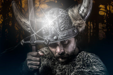 War, Viking warrior, male dressed in Barbarian style with sword,