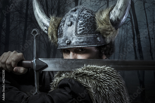 Defense, Viking warrior, male dressed in Barbarian style with sw