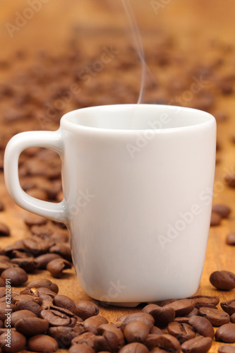a cup of espresso with coffee beans
